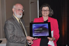 SPIE Vice President Maryellen Giger presents SPIE Fellow plaque to Laurence Clarke