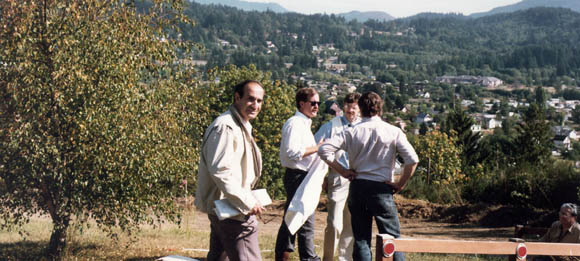 Joe Yaver, at left, reviews blueprints and site plans for the current SPIE headquarters in Bellingham, completed in 1983.
