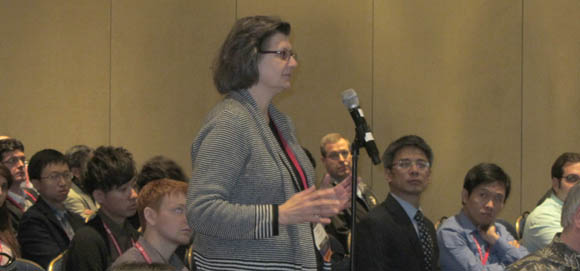 Maryellen Giger asks a question from the audience during presentations by LUNGx Challenge participants during the 2015 conference