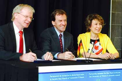 Signing the agreement at the University of Ottawa: