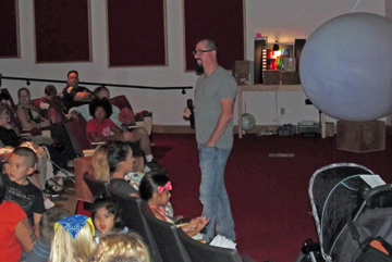 Yakima Valley artist Andy Behrle interacts with the audience at LIGO Hanford following his presentation on September 26.