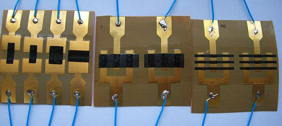 Polymer-based flexible temperature sensors for bio-signal monitoring in textronic applications.