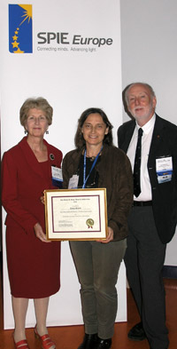 Jannick Roland, center, holds a certificate announcing the 2008 Kidger Scholarship awarded to her student Tobias Schmid. The award was presented by Tina Kidger, left, and David Williamson, right.
