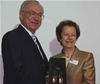 Photo: Lothar Späth with his SPIE Visionary Award, and SPIE President Maria Yzuel.